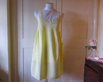 1920's style yellow empire line crepe and net nightdress with flower detail.