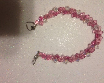 Pink and Clear Swarovski flashy top drilled crystal bracelet.
