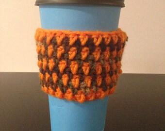 Orange and camo coffee cozy