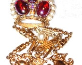 Outstanding Iridescent Red Crown Brooch with Charms on Watch Fob Style Chain Attributed to Florenza