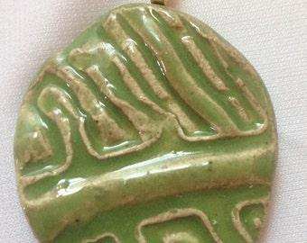 Avacado ceramic pendant.