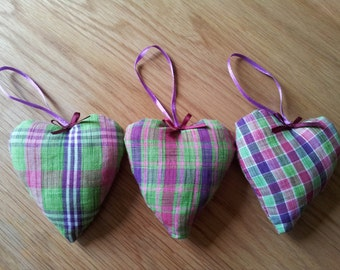 A set of 3 handmade vibrant coloured padded fabric decorative hearts