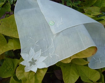 White handkerchief with applique flower and embroidery.  Made in Hong Kong by Linbro.