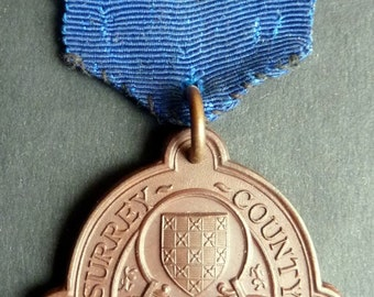 Bronze British School Attendance Medal. Surrey County Council. Named to Violet Ford & Dated 1905