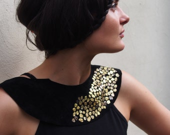 Suede collar, with brass detail.