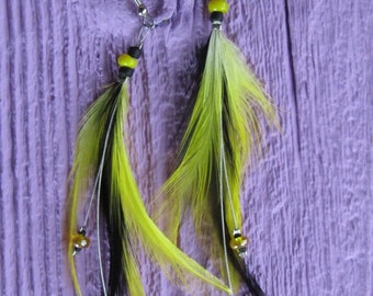 Earrings made with feathers and glass beads