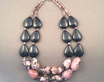 Statement necklace with rhodoite and black agate with sterling silver clasp.