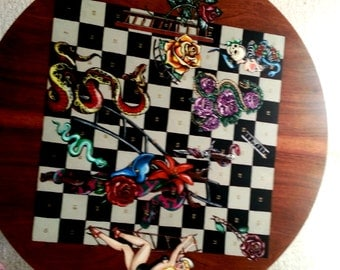 Retro Coffee Table hand painted with a Snakes n Ladders board using 1950s Tattoo images