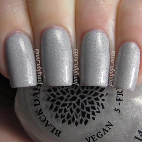 Light Gray Shimmer Nail Polish With Flakies By