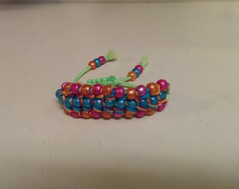 3 row beaded bracelet with sliding closure.