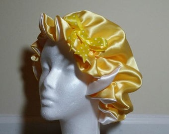 Yellow and white reversible satin bonnet