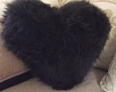 Sheepskin heart cushion with a Dorset story in chocolate brown and suede reverse side