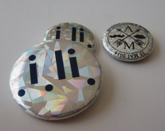 Silver holographic badge