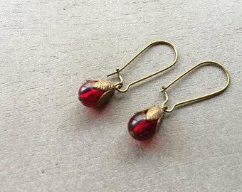 vintage ruby colored glass drop earrings on antiqued brass hooks