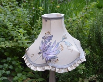 A small embroidered silk lampshade, vintage frame