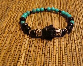 Turquois Women's Buddha bracelet, Turquois Buddha, genuine turquois, size 6 - 6.5 Inches.