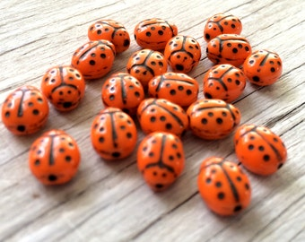 lady bug beads, lady bugs, Czech glass ladybug beads orange 9x7mm pack of 20 (B12)