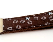 Dark Brown Background with Bright Light Blue Circles and Stars on a Brown Heavy Duty Wristlet Keychain FOB