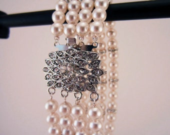 Pearl bracelet. Bridal jewelry, four strands of pearls with rhinestone clasp and spacers. Ivory white and silver.