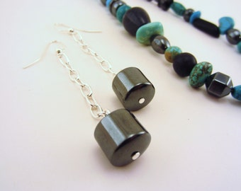 Long earrings. Silver earrings. Drop earrings. Shiny black slate cylinder stones. Silver plated chain. Gift for her.