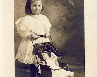 ADORABLE Little Girl in White Cotton Dress Pushes DOLL in CARRIAGE Photo Postcard Circa 1910