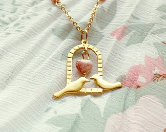 Love birds, long necklace with pastel coral pink beads an a tiny heart