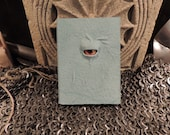 Mythical Beast Book (Mini notebook Sky Blue leather with Yellow/Orange eye)