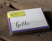 6 pack hello letterpress cards, in papaya or black letterpress printed card. Eco friendly