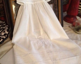 Slip listing for a Initial christening gown.