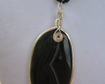 Onyx and crystal necklace with pendant.