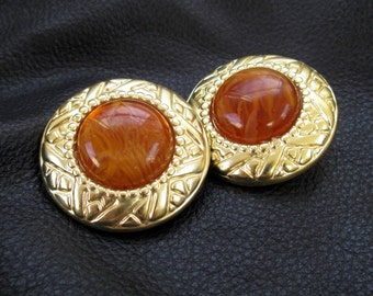 Chunky round earrings, gold tone, faux amber, brown Lucite, embossed oversized clip-on earrings, vintage, 80s