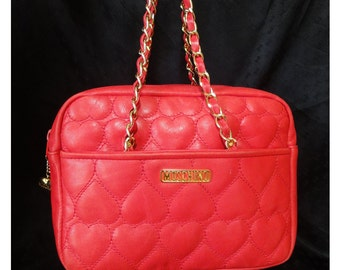Vintage MOSCHINO red heart shape quilted lambskin shoulder purse with chain straps. Too cute to carry.
