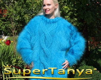 Thick hand knitted aqua blue mohair sweater with cables by SuperTanya