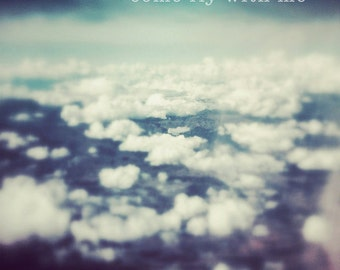 Photograph of sky and clouds, quote, above the clouds