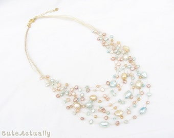 Multistrand light blue peach freshwater pearl necklace with crystal on gold silk thread