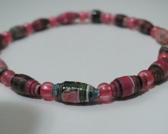 Pink magazine paper bead Bracelet with stretch cord. Upcycled, recycled and one of a kind