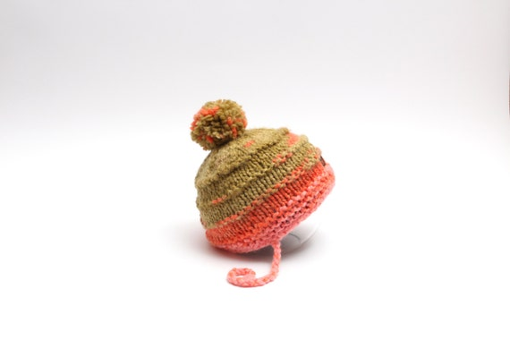 Green / orange / pink children pom pom hat with laces and lining inside. Size 9-24 months, ready to ship. Warm toddler winter hat.
