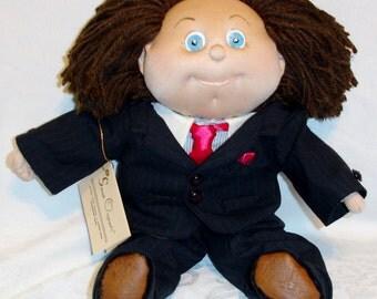 Mat is a 14 Inch Soft Sculpture Doll Dapper in a Two Piece Suit & Tie- Sarah Originals Dolls