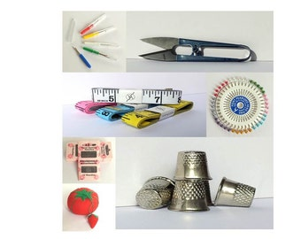 Sewing essentials, pins and needles, retro tomato pin cushion with strawberry emery, scissors snips, metal thimbles, coloured measuring tape