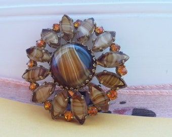 Large amber tone glass flower brooch