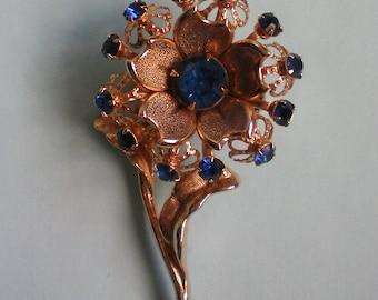 Intricate Design Gold tone Blue Rhinestone Flower Brooch - 2913