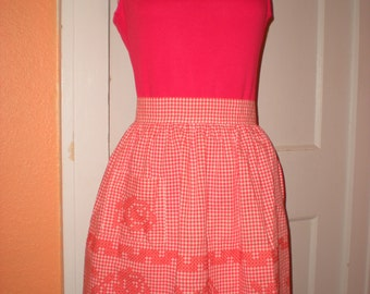 "Handmade vintage orange gingham cross stitched apron Size small 17"" waist band. Rose pattern"