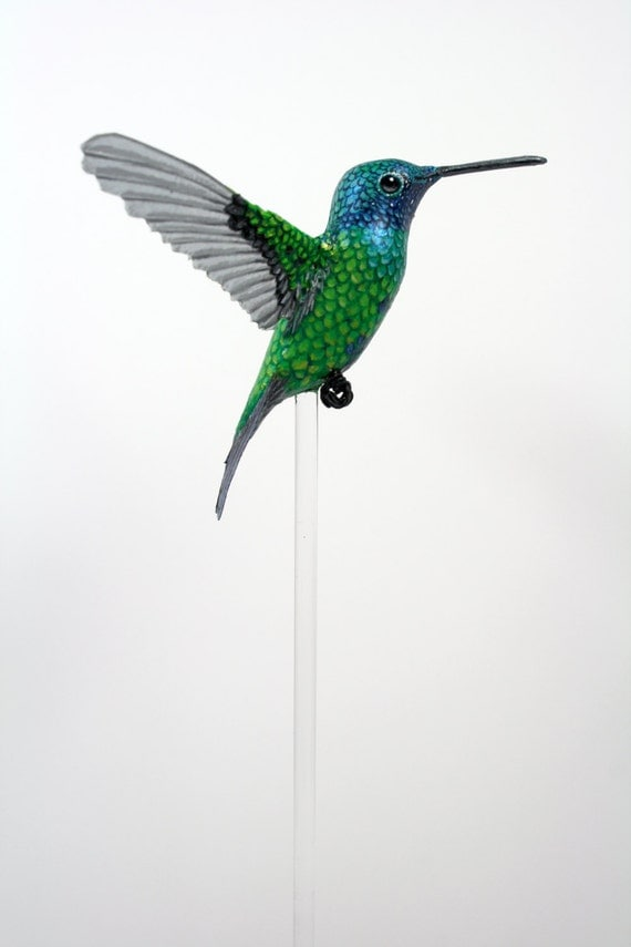 Handmade paper and resin hummingbird.