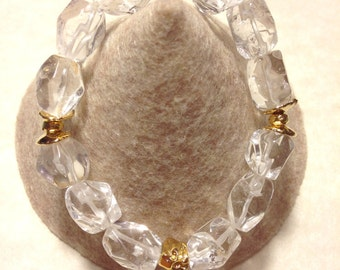 Genuine crystal quartz stretch bracelet with  gold plated details