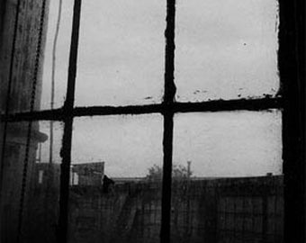 Black and white architectural photography: old window panes silhouette, urban industrIal, textured. Moody, mysterious. Contemporary art.