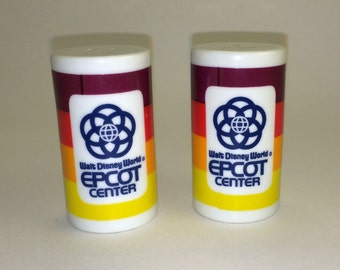 EPCOT Center Salt and Pepper Shakers in Red Orange and Yellow from Walt Disney World.  Made of ceramic with a retro look!