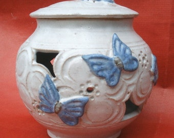 Hand thrown, carved and decorated jar 12cmx13cm