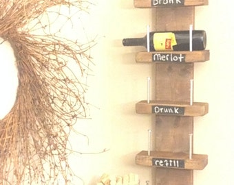 Rustic wine rack with an industrial touch. Holds 5 wine bottles and can be custom stained or painted any color you would like, or unfinished