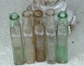 Antique Lot of 5 Hartshorn & Son MA embossed Americana pharmacy quack science cure all bottles tinted green yellow and clear glass patinas