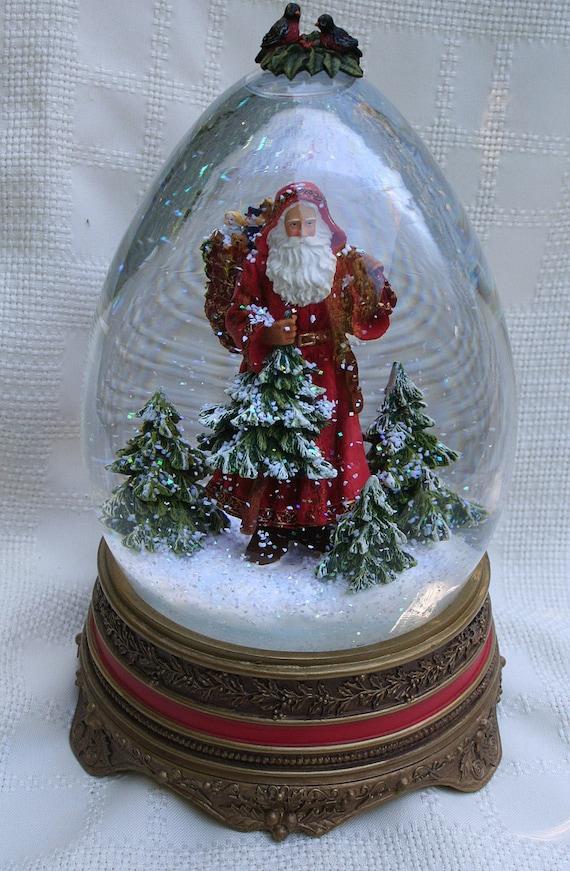 Vintage father christmas santa claus snow globe music box